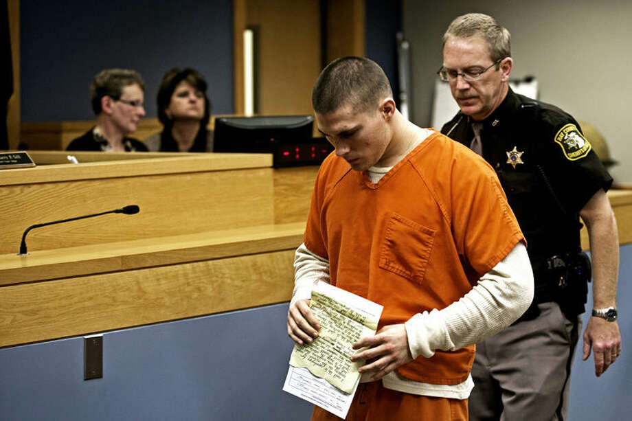 Hunter Motko walks out of Circuit Judge Harry P. Gill's courtroom after receiving his sentence at the Bay County Court Facility. Motko was sentenced to concurrent terms of 86 months to 15 years and 40 months to five years in prison for his role in the death of Vaughn Lietzke after Motko drove a car while drunk into the Lietzke's Auburn home.
