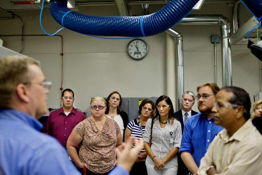 Dow Corning Global Manager, Lab Safety and Facilities, Jeffrey Foisel, left, speaks to educators from Saginaw Valley State University and area high schools and middle schools during a tour of one of the labs on Monday at the Corporate Center. Photo: Nick King | Midland Daily News