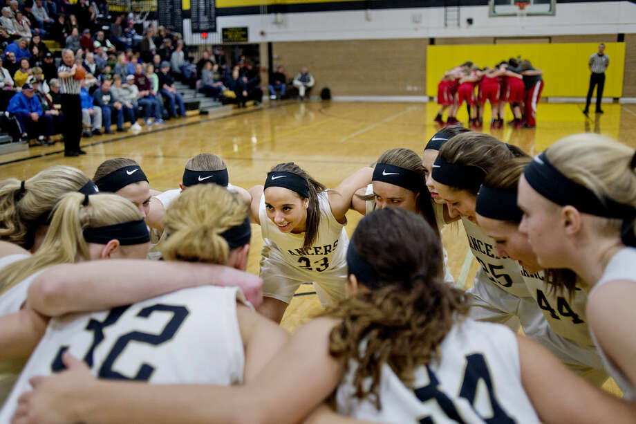 Bullock Creek's Shelby Bailey, center, and the rest of the lady Lancers form a circle as they prepare to take on Frankenmuth before the start of the basketball game on Monday at Bullock Creek High School. Photo: Nick King/Midland  Daily News