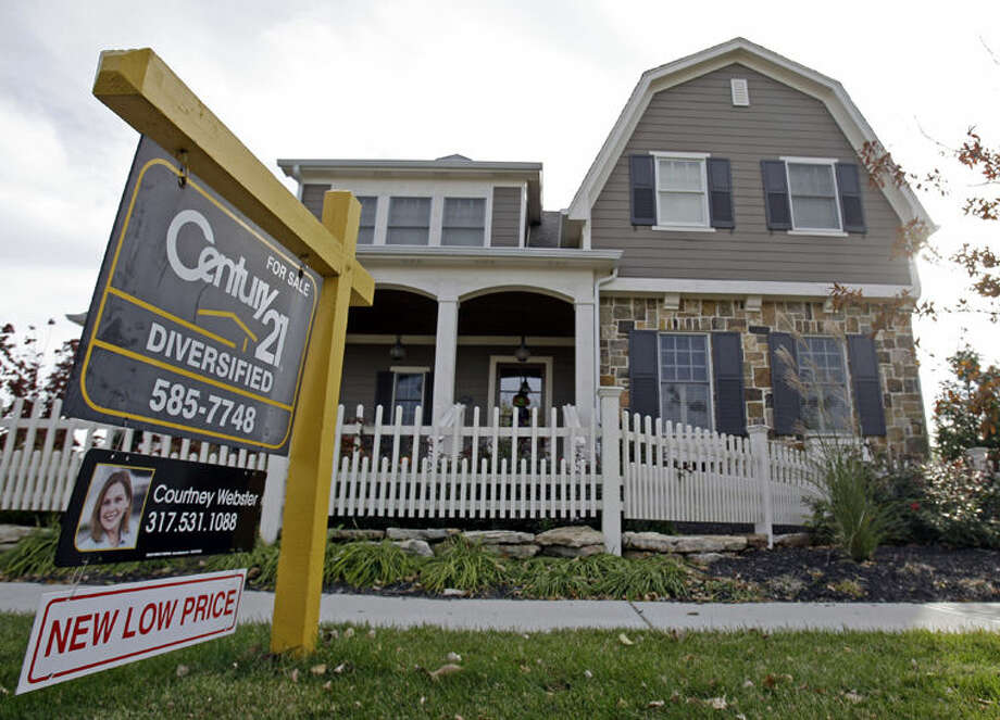 FILE - This Oct. 20, 2009, file photo, shows a home with a reduced price for sale in Carmel, Ind., neighborhood. Short of cash and unsettled in their careers, young Americans are waiting longer than ever to buy their first homes. The delay reflects a trend that cuts to the heart of the financial challenges facing millennials: Renters are struggling to save for down payments. (AP Photo/Michael Conroy, File) Photo: Michael Conroy
