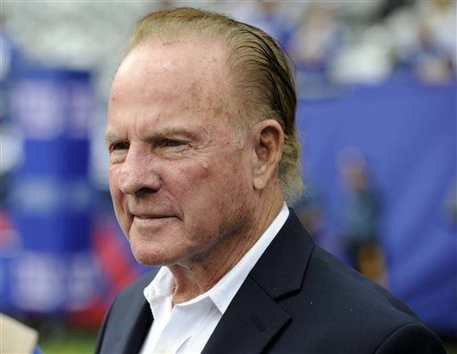 In this Sept. 15, 2013 file photo, former New York Giants player Frank Gifford looks on before an NFL football game between the New York Giants and the Denver Broncos in East Rutherford, N.J. In a statement released by NBC News on Sunday, his family said Gifford died suddenly at his Connecticut home of natural causes that morning. He was 84. Photo: Bill Kostroun | Associated Press