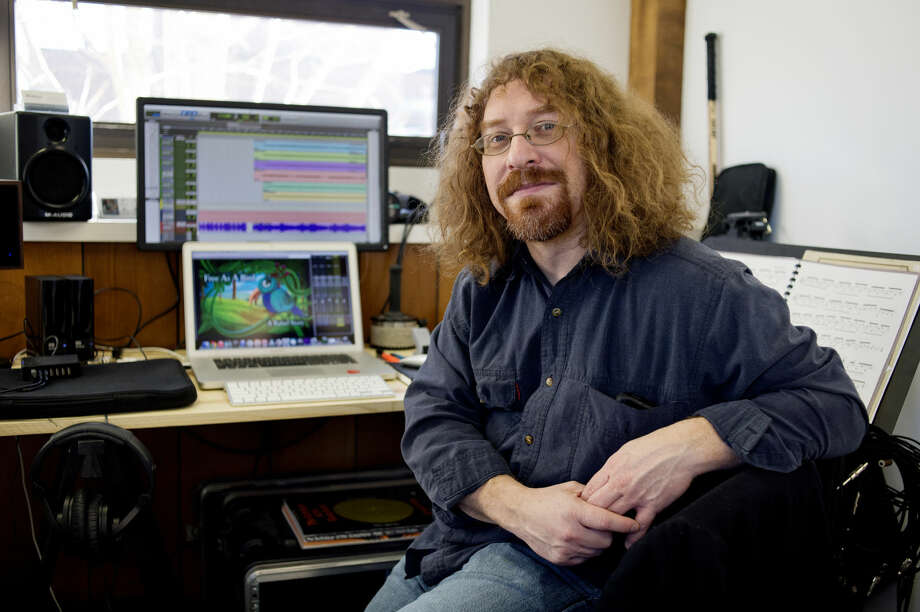 NEIL BLAKE | nblake@mdn.net Dan Belleville, a musician, composer and educator, recently opened up a studio in Midland. Belleville has composed music for television shows, films and video games and also teaches music lessons. Photo: Neil Blake/Midland Daily News