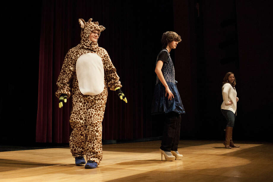Dressed as a giraffe, Bullock Creek freshman Zach Kaufman takes the stage with freshmen Nick Conley and Haley Northup during a dress rehearsal on Thursday for a fashion show in Nancy Hoefer's Spanish I class. Photo: NEIL BLAKE | Nblake@mdn.net