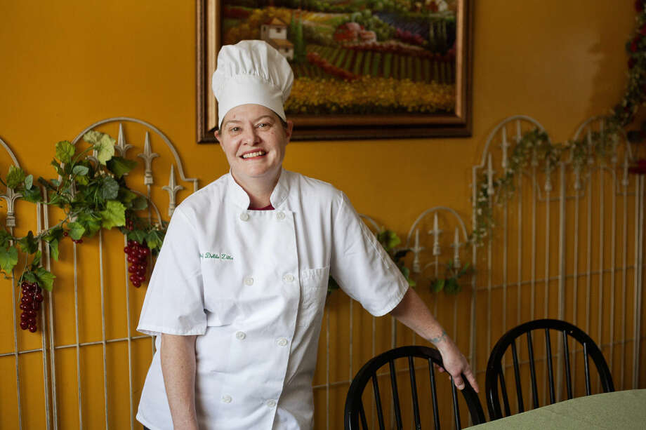 Chef Delite Zitta poses for a photo in Little Italy in Sanford. Zitta has operated the restaurant for seven years. Photo: NEIL BLAKE | Nblake@mdn.net