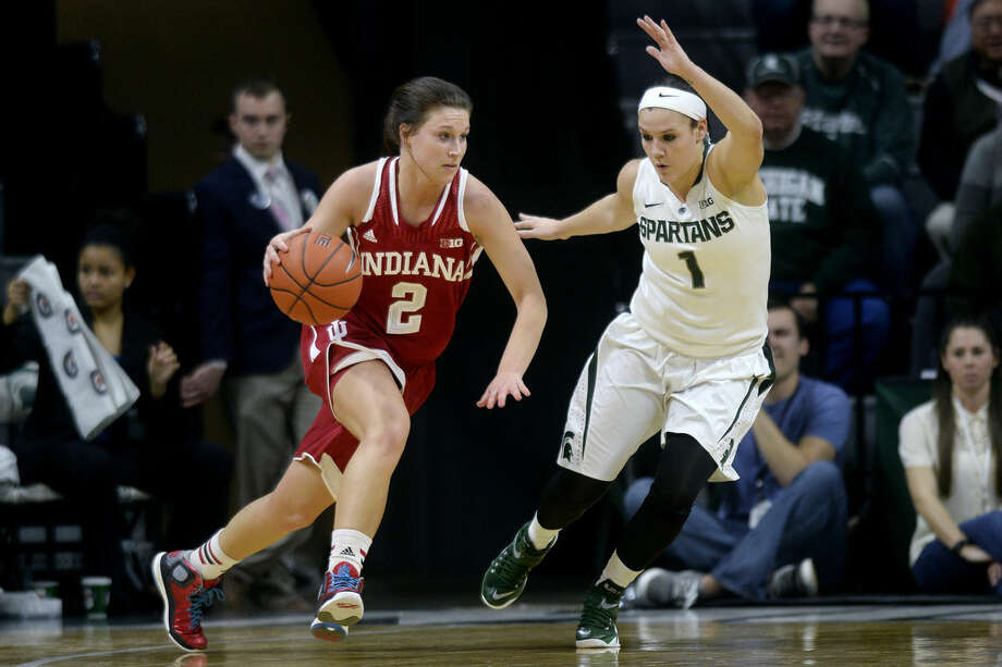 Indiana's Jess Walter, left, moves past Michigan State's Tori Jankoska during the first half on Wednesday at the Breslin Center in East Lansing. Michigan State won 72-57. Photo: NICK KING | Nking@mdn.net