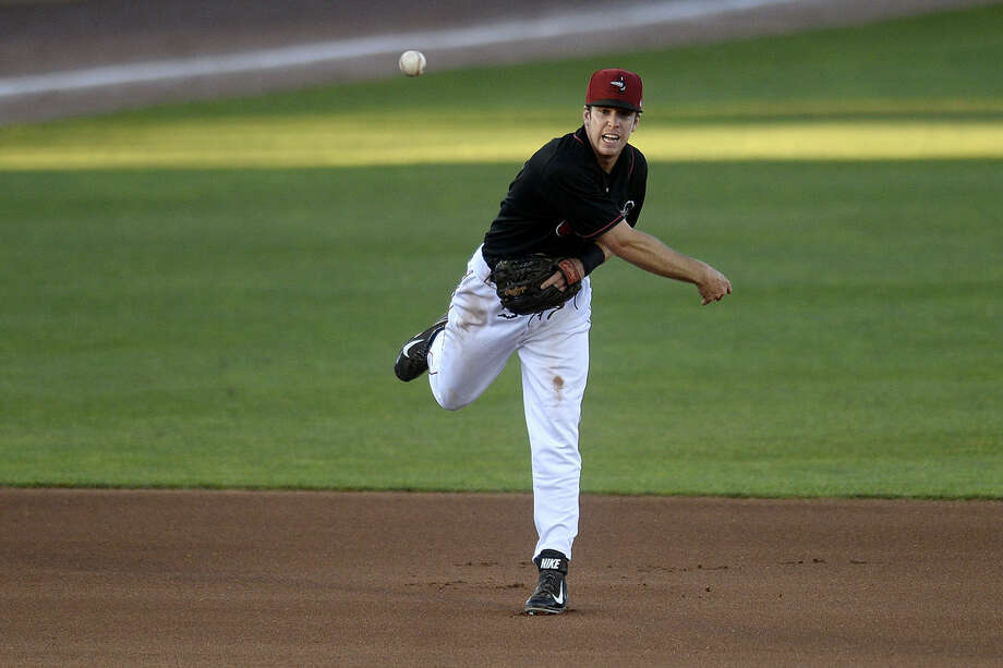 The Loons' Nick Dean throws the Snappers' Mikey White out at first base after fielding the ball during the fourth inning on Tuesday at Dow Diamond. The Great Lakes Loons fell to the Beloit Snappers 2-0. Photo: Nick King | Nking@mdn.net