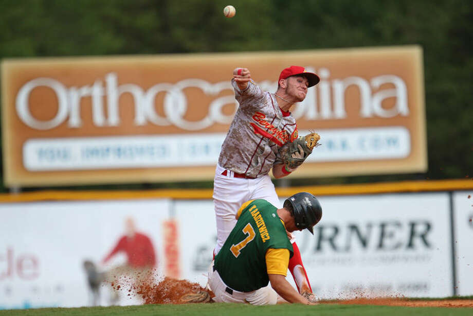 Midland's Connor Smith tags the base and throws to first while Cromwell, CT, player Kevin Radziewicz slides into second during the ALWS game two Northeast vs. Great Lakes Thursday afternoon at Keeter Stadium. Photo: Hannah Covington