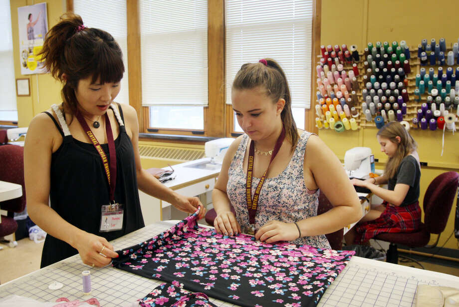 A high school student works on her garment during Fashion Camp photo by Emily Mesner Photo: Emily Mesner