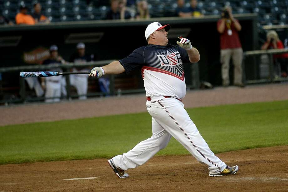 NICK KING | nking@mdn.net USA's Brett Helmer hits a home run in the first inning during the Border Battle VII on Tuesday at Dow Diamond. Team USA beat Canada 20-7. Photo: Nick King/Midland Daily News