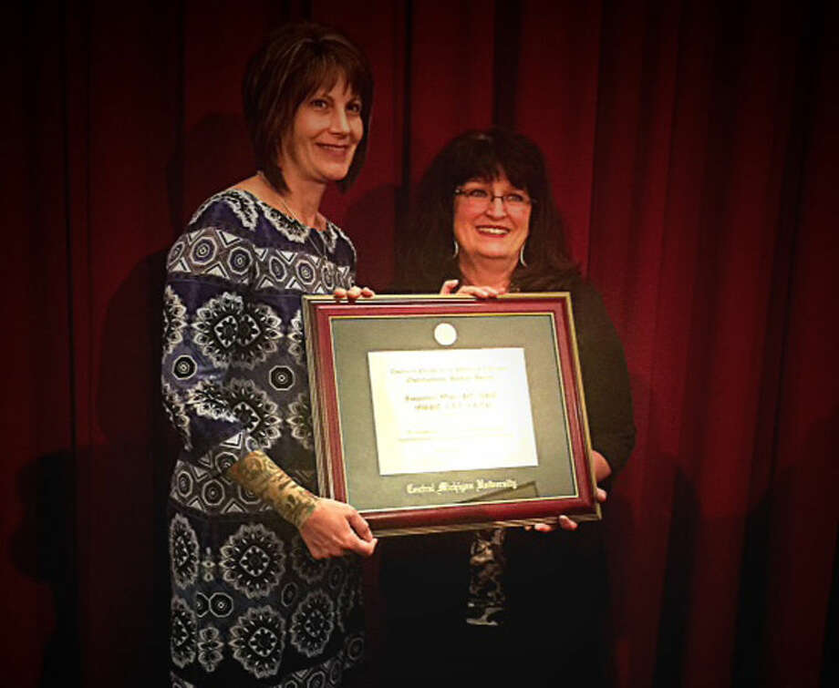 Physical Therapist Jacqueline Wiley is presented the 2015 Outstanding Alumni Award for the Physical Therapy Program at Central Michigan University by Karen E.H. Grossnickle. Photo: Photo Provided