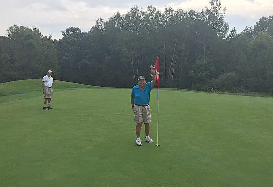 Midland's Dean Rainey is pictured shortly after recording his ace at Currie West. Photo: Photo Provided
