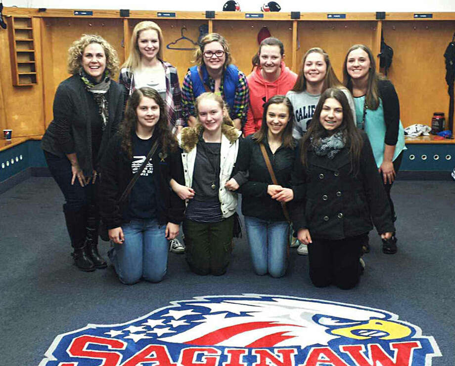 Midland High School students visit the Saginaw Spirit. MHS and St. Charles High School won a grand prize limo package to a Saginaw Spirit hockey game from Michigan Blood. Photo: Photo Provided