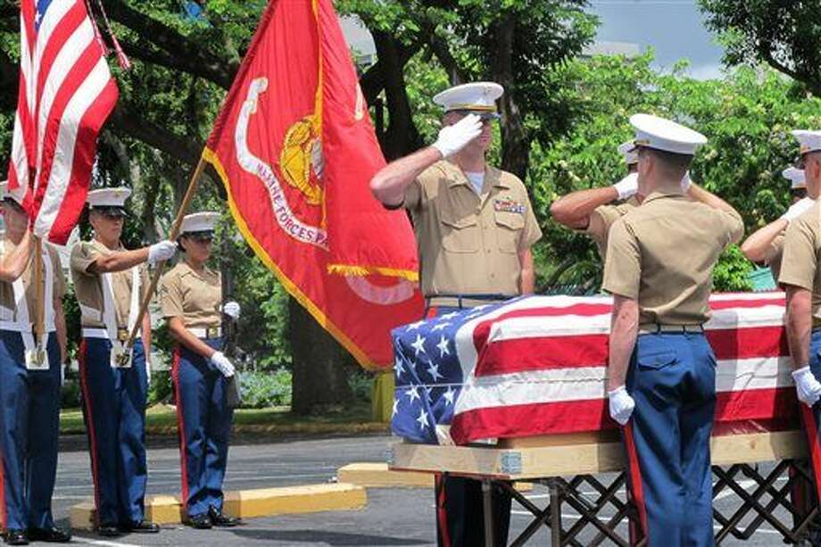 United States Marines salute during a Thursday, Sept. 24, 2015, ceremony in Honolulu for the departure of 1st Lt. Alexander Bonnyman's remains. The recently identified remains of Bonnyman who was hailed for his bravery in battle are heading home 72 years after he was killed on a remote Pacific atoll during World War II. (AP Photo/Audrey McAvoy) Photo: Audrey McAvoy