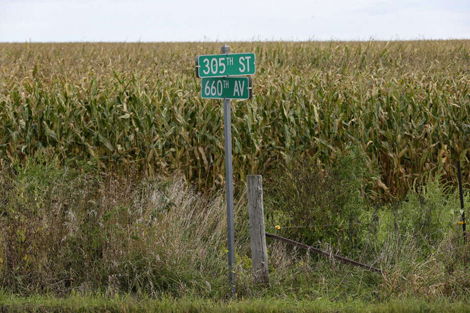 A street sign is shown in front of a corn field at an uncontrolled rural intersection where a driver was killed in an August crash near Maxwell, Iowa. Corn grows up to 12 feet tall and this time of year can be a serious hazard for motorists in rural areas of the Midwest. Photo: Charlie Neibergall | AP Photo