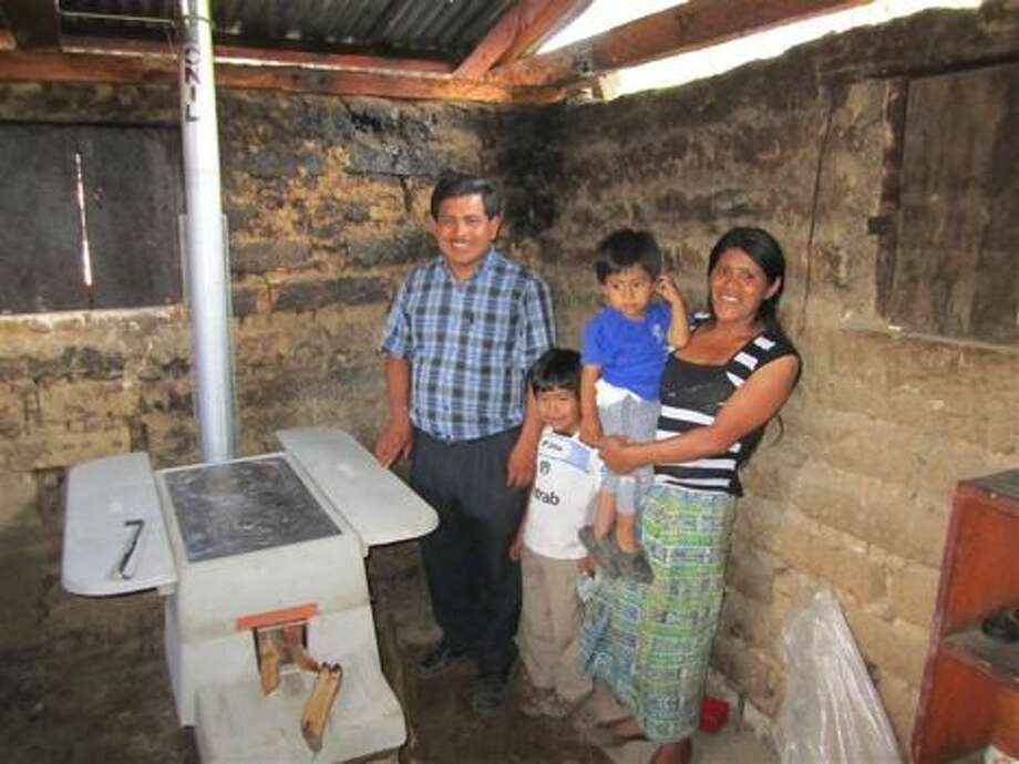 Mayan family with their new indoor stove.