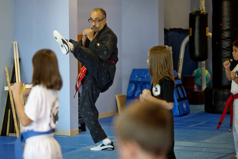 Angel De Jesus, center, works with a class at Angel's Karate and Mixed Martial Arts Center. Photo: Nick King | Midland Daily News