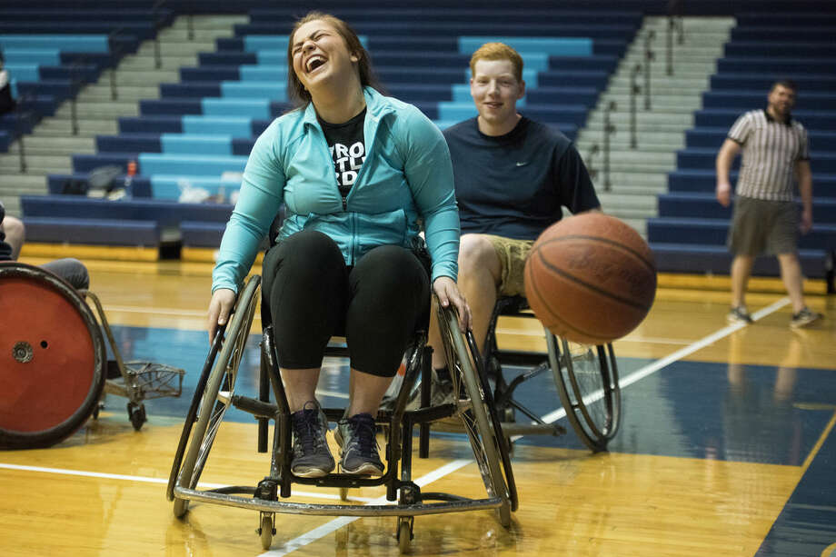 "Style Show player Chloe Kinsey of Monroe laughs as the basketball bounces away from her and Alpha Chi Rho opponent Logan Schupp of Rudyard during a wheelchair basketball tournament on Wednesday at the Bennett Sports Center at Northwood University in Midland. The tournament, in its seventh year, is hosted by student service club Circle K and benefits the Special Olympics. The single-elimination tournament included seven teams playing basketball while using special sport wheelchairs. Each game was comprised of six-minute halves with small contests for Special Olympics participants in between game times. ""This is a great opportunity for (Circle K) to get our name out there,"" said club president Justine Arvizu. ""I'm happy so many people came out for this opportunity to raise money for the Special Olympics."" Photo: Danielle McGrew/Midland Daily News"
