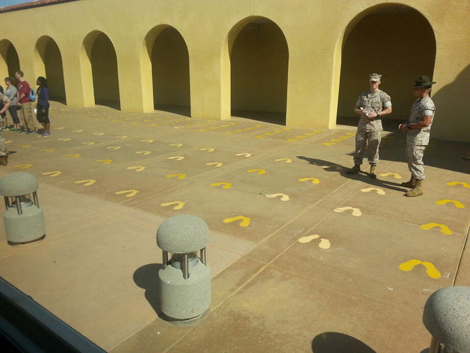 The famous Yellow Footprints. This is where recruits first get off the bus at the Marine Corps Recruit Depot. Can be a very frightening place for a young fellow. Or an old dude like me. Photo: Photo By Matthew Woods