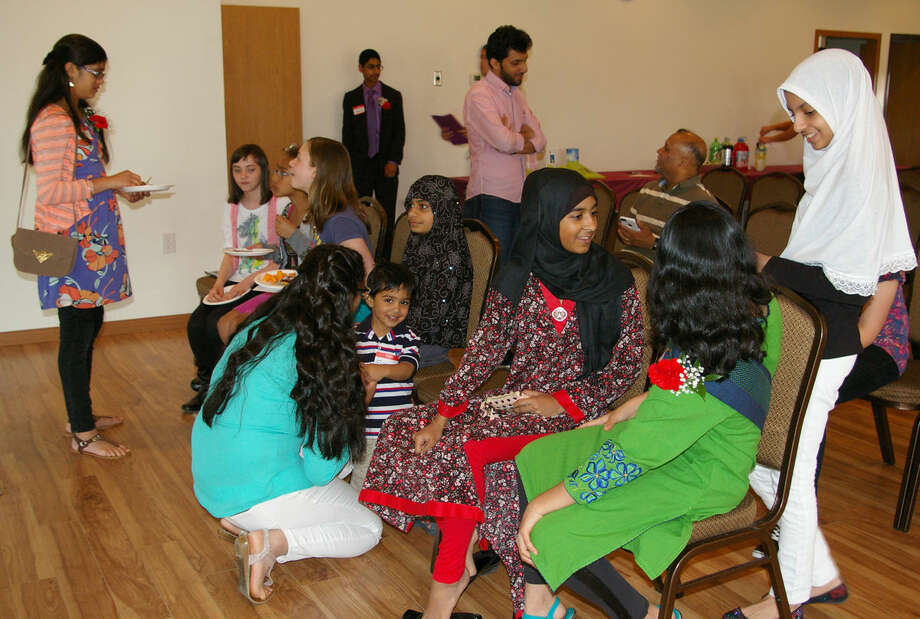 Youth of all age groups attended an interfaith event at the Islamic Center in Midland Friday night. The event, hosted by the Muslim Youth of Mid-Michigan, shared a message of peace, despite differences in religion or culture. Photo: NIKY HOUSE/Midland Daily News