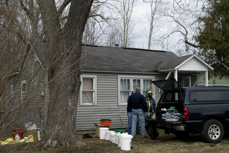 Homer Township Fire Department, BAYANET, Michigan State Police and Midland County sheriff deputies were at the scene when a search warrant was conducted Tuesday. Photo: Brittney Lohmiller | Blohmiller@mdn.net