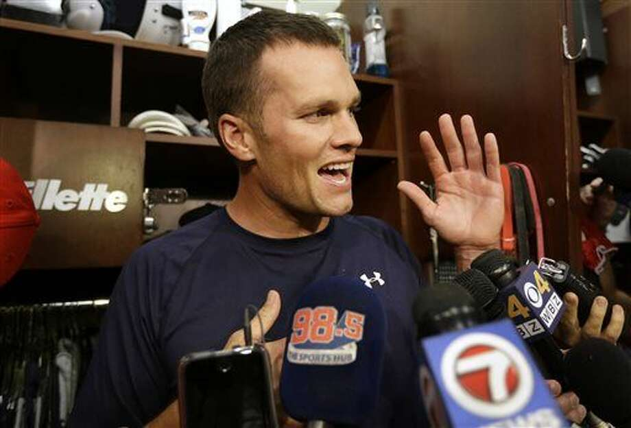 New England Patriots quarterback Tom Brady speaks with members of the media in the locker room before an NFL football practice Wednesday. Photo: Steven Senne | AP Photo