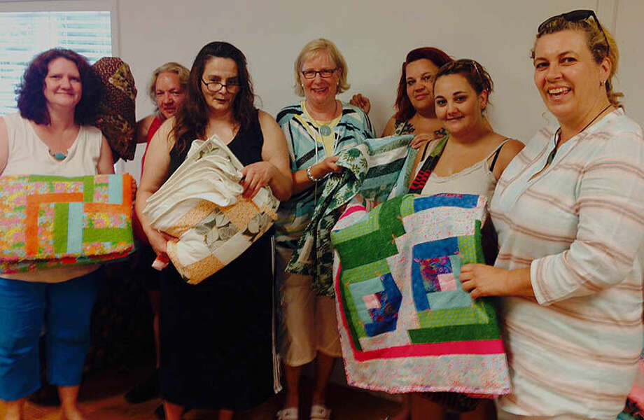 A group known as the Rainbow Crafters recently presented quilts to guests at the House of Mercy. Photo: Photo Provided