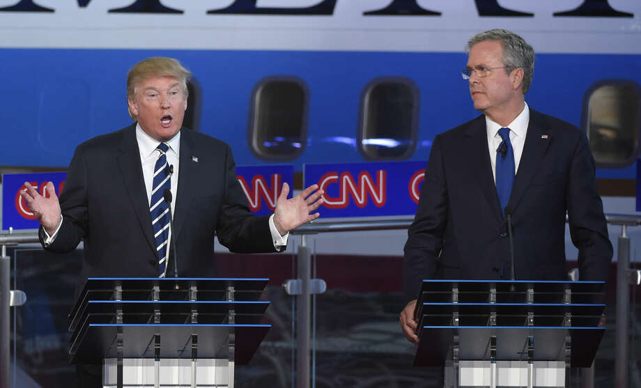 Republican presidential candidate, businessman Donald Trump, left, speaks as Jeb Bush looks on during the CNN Republican presidential debate at the Ronald Reagan Presidential Library and Museum on Wednesday, Sept. 16, 2015, in Simi Valley, Calif. (AP Photo/Mark J. Terrill) Photo: Mark J. Terrill