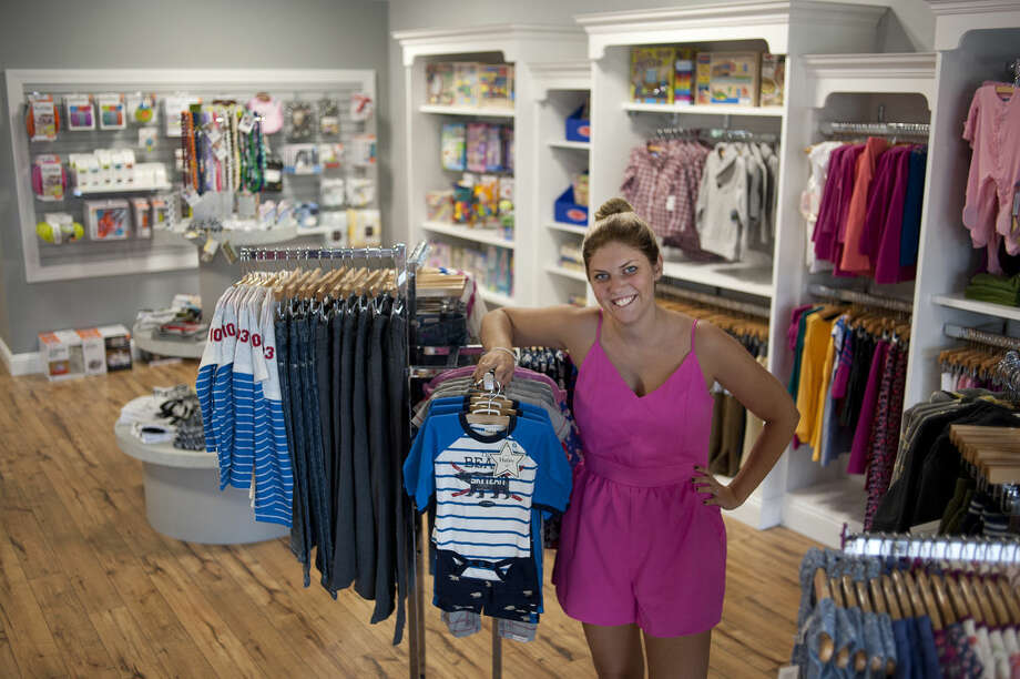 Chelsea Serra opened Annie & Oliver's, a children's boutique, in August. The store sells children's clothing up to size 8 as well as toys. Photo: Brittney Lohmiller | Midland Daily News