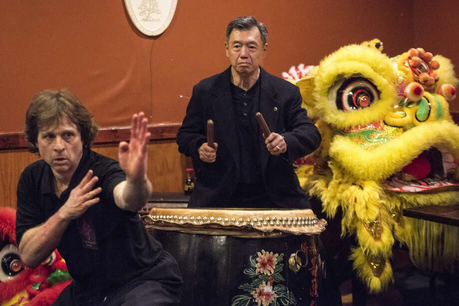 Sifu Tony Chuy of New York City plays the drum as John Wicker of Indianapolis demonstrates kung fu forms during a celebration at Golden Buffet on Saturday after Wicker and three others were initiated as disciples of Sifu (Master) Henry Chung. Kung fu martial artists from Michigan, Indiana, South Carolina and Brazil gathered to celebrate a disciple ceremony and Chung's 60th birthday. Photo: Danielle McGrew Tenbusch | For The Daily News