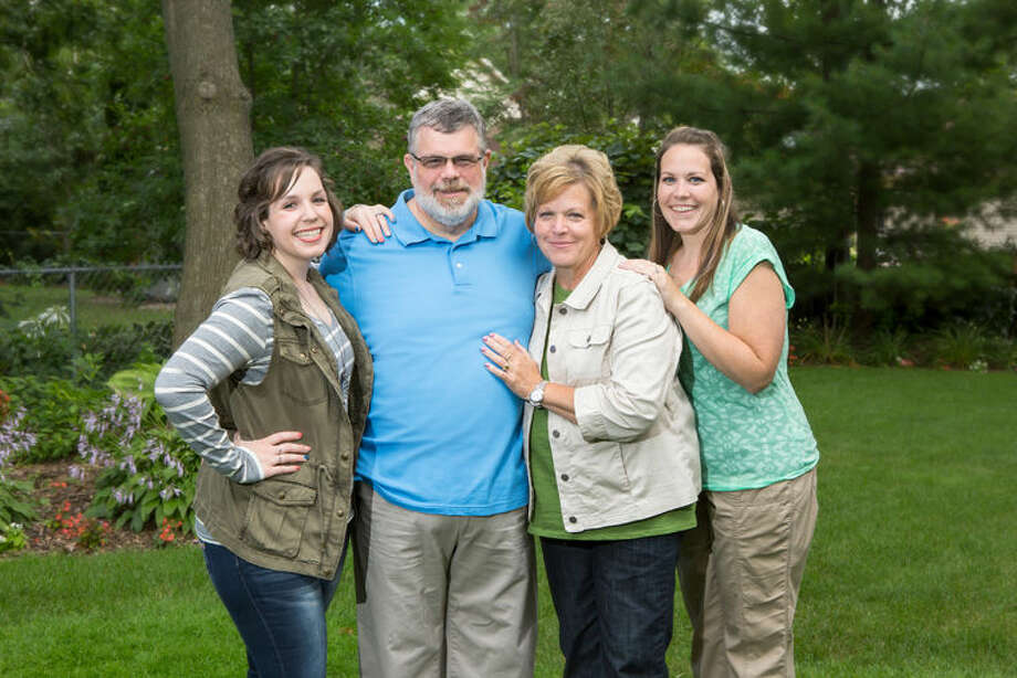 Together, Steve and Peggy Kalafut and their two daughters, Jenny and Katy, have lost more than 420 pounds and gained better health, energy and self-confidence. Photo: Photo Provided