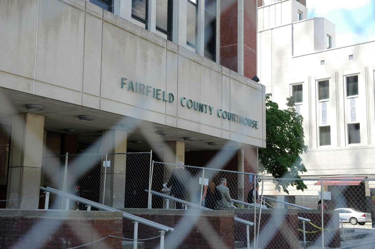A 6-foot-high Cyclone fence and yellow police tape outline a project to repair the half-block length of slate stairs in front of the Fairfield County Courthouse, part of a program to spruce it up for its 40th anniversary.