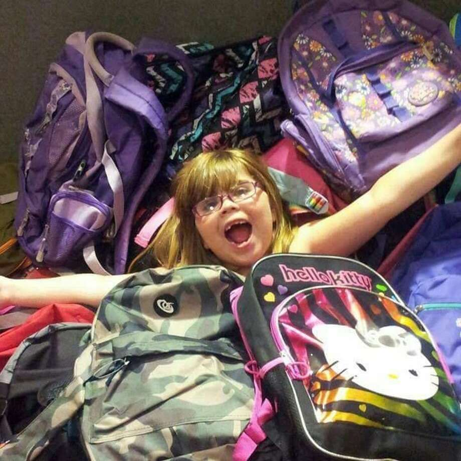 Photo provided Abbigayle Grace West with some of backpacks she collected forGladwin students.