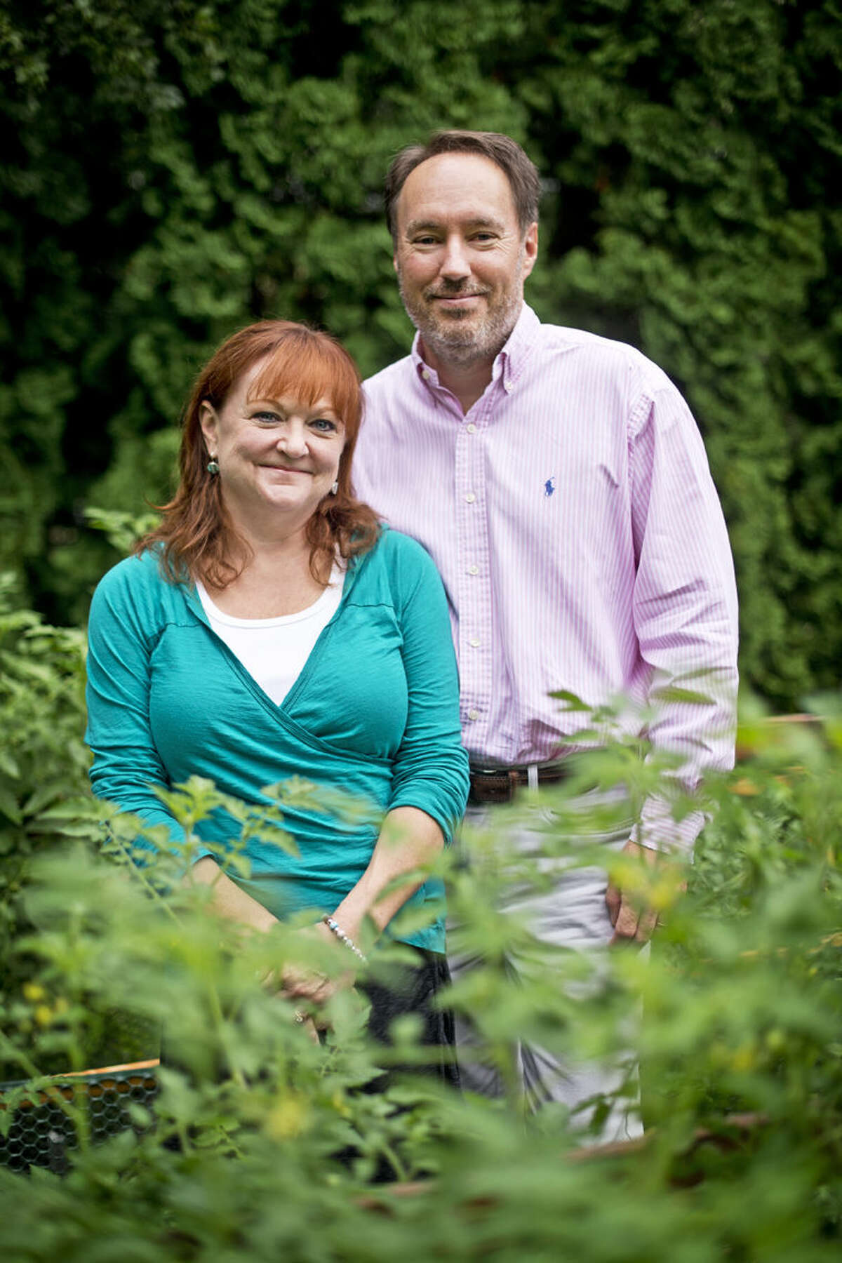 Carole and Kim Donaghy pose for a portrait in their garden at their Midland home.