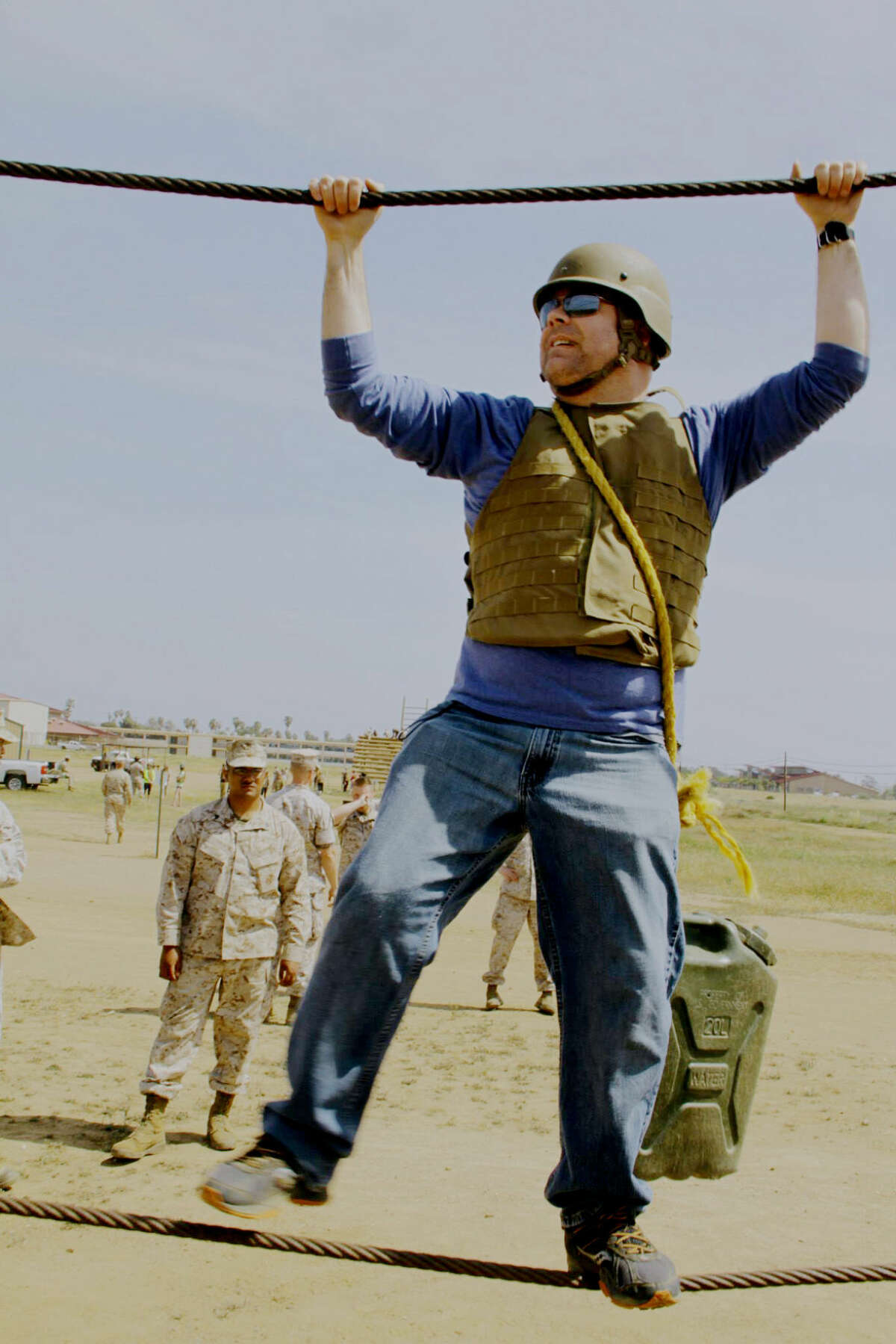 Daily News reporter Matthew Woods crosses a cable obstacle while at Camp Pendleton, north of San Diego, Calif.