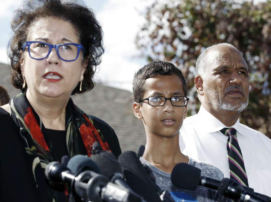Ahmed Mohamed, 14, center, and his father Mohamed Elhassan Mohamed, right, look on as their attorney Linda Moreno, left, delivers a statement about the arrest of Ahmed during a news conference, Wednesday, September 16, 2015, in Irving, Texas. Ahmed was arrested after a teacher thought a homemade clock he built was a bomb. (AP Photo/Brandon Wade) Photo: Brandon Wade