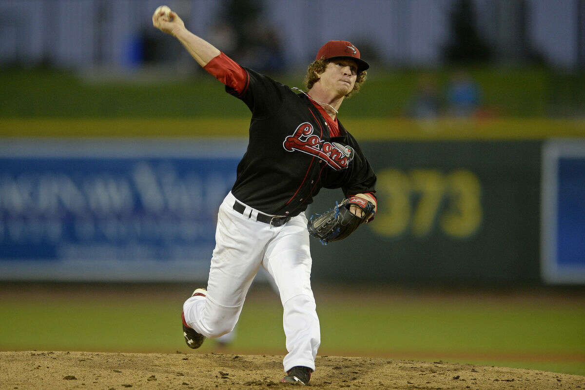 Great Lakes Loons pitcher Grant Holmes delivers a pitch to a Lansing Lugnuts player Wednesday during a playoff game at Dow Diamond.