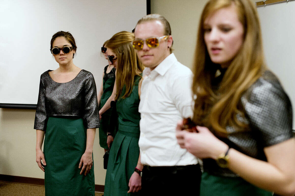"""Northwood University senior Becca Ferreira, left, models a dress designed by senior Loraine Carlsen to get approval for the 2015 Northwood University Style Show. The show is on April 17 at 8 p.m. and the theme is """"Labels of Love."""""""