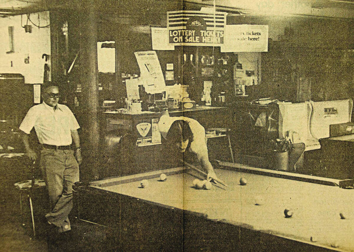 """This photo by Terry L. Tanner of the Daily News was captioned: The crack of pool balls being broken from a rack has been muffled at the corner of Main and Benson Streets. The photo accompanied an article, titled """"An era passes,"""" on Shorty's Pool and Card Room on Thursday, June 17, 1976."""