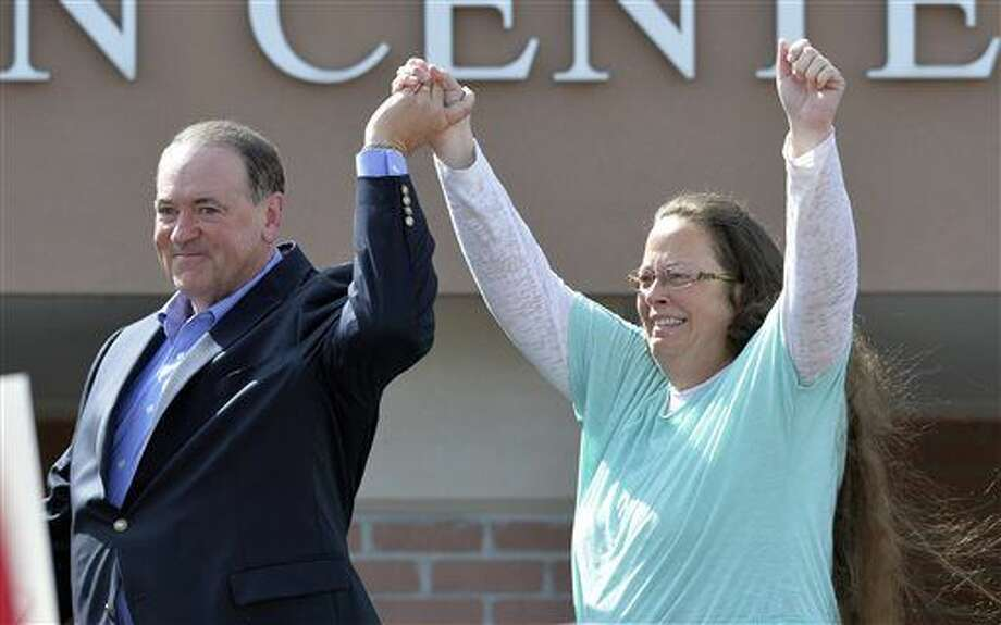 In this Sept. 8, 2015, file photo, Rowan County Clerk Kim Davis, with Republican presidential candidate Mike Huckabee at her side, greets the crowd after being released from the Carter County Detention Center, in Grayson, Ky. Davis, a longtime Democrat, says she is switching to the Republican Party because she feels abandoned by Democrats in her fight against same-sex marriage. Photo: Timothy D. Easley | AP Photo, File