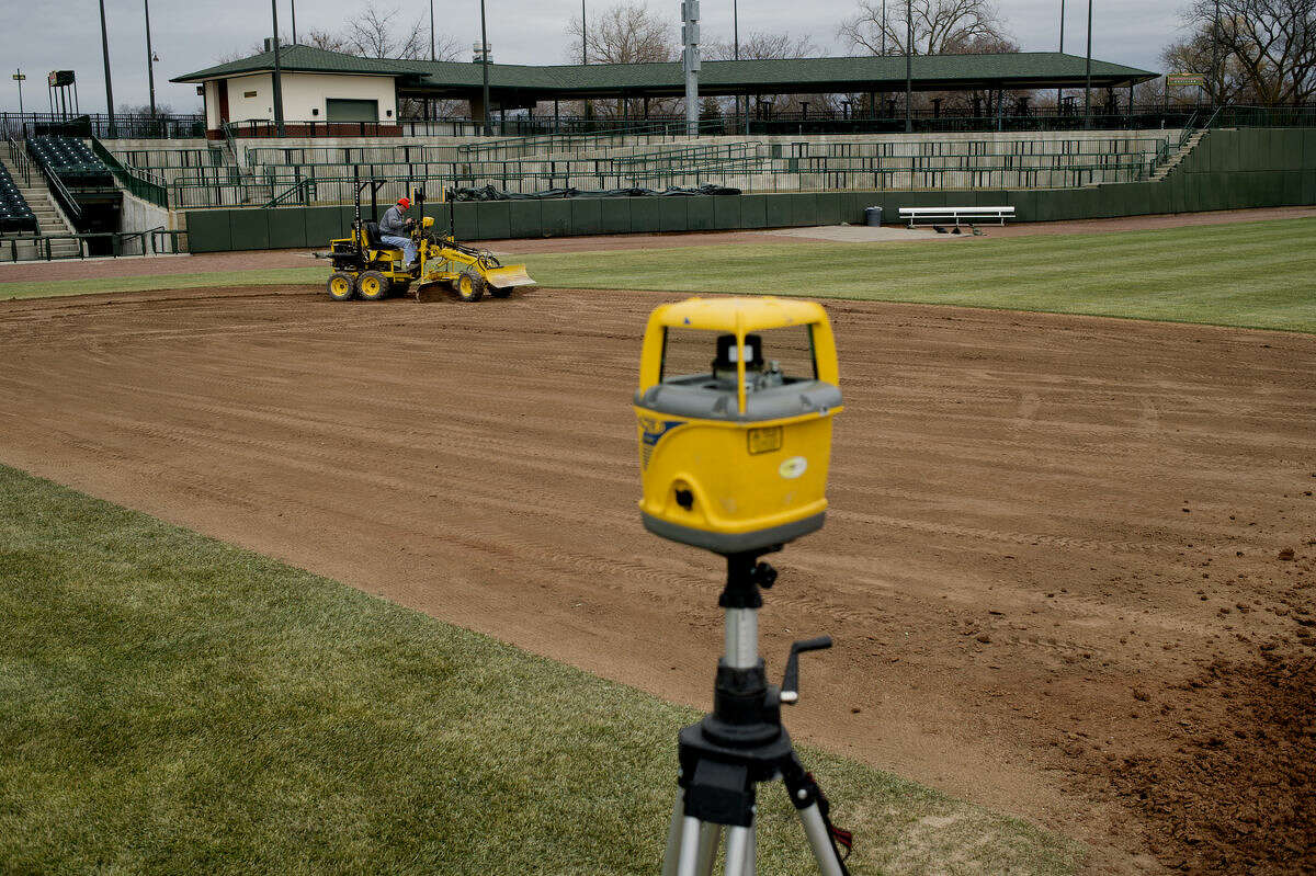 Lance Hauserman with Homefield Turf & Athletic uses a laser leveling system to grade the infield at Dow Diamond on Thursday. The Great Lakes Loons grounds crew is working to prepare the field for opening day on Thursday, April 9.