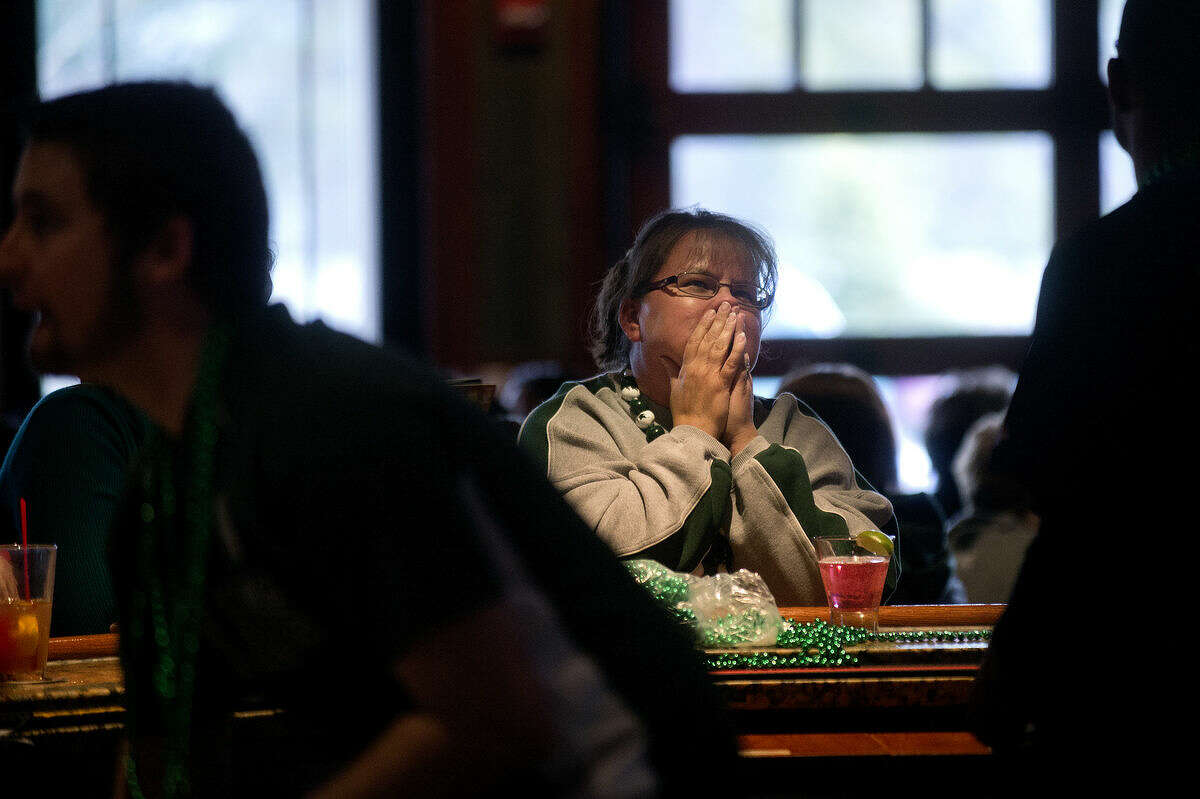 Beth Riordan reacts while watching the Michigan State game with her husband Tom at Big E's Sports Bar on Saturday. Tom graduated from Michigan State in 1984. Midland area bars were filled with fans to watch MSU take on Duke in the first Final Four game of the night.