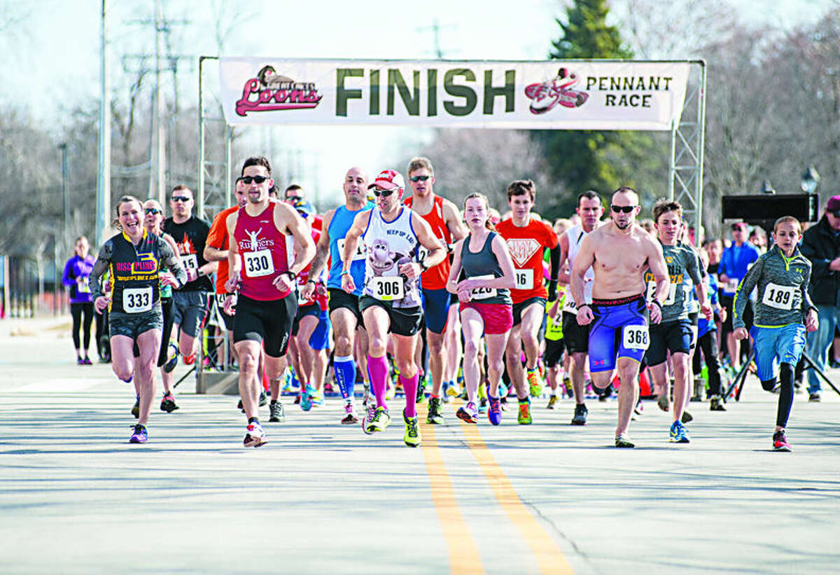 Second place finisher #330 Michael Barrows leads the pack at the start of the The Great Lakes Loons 5K Run Pennant Race Saturday at Dow Diamond.