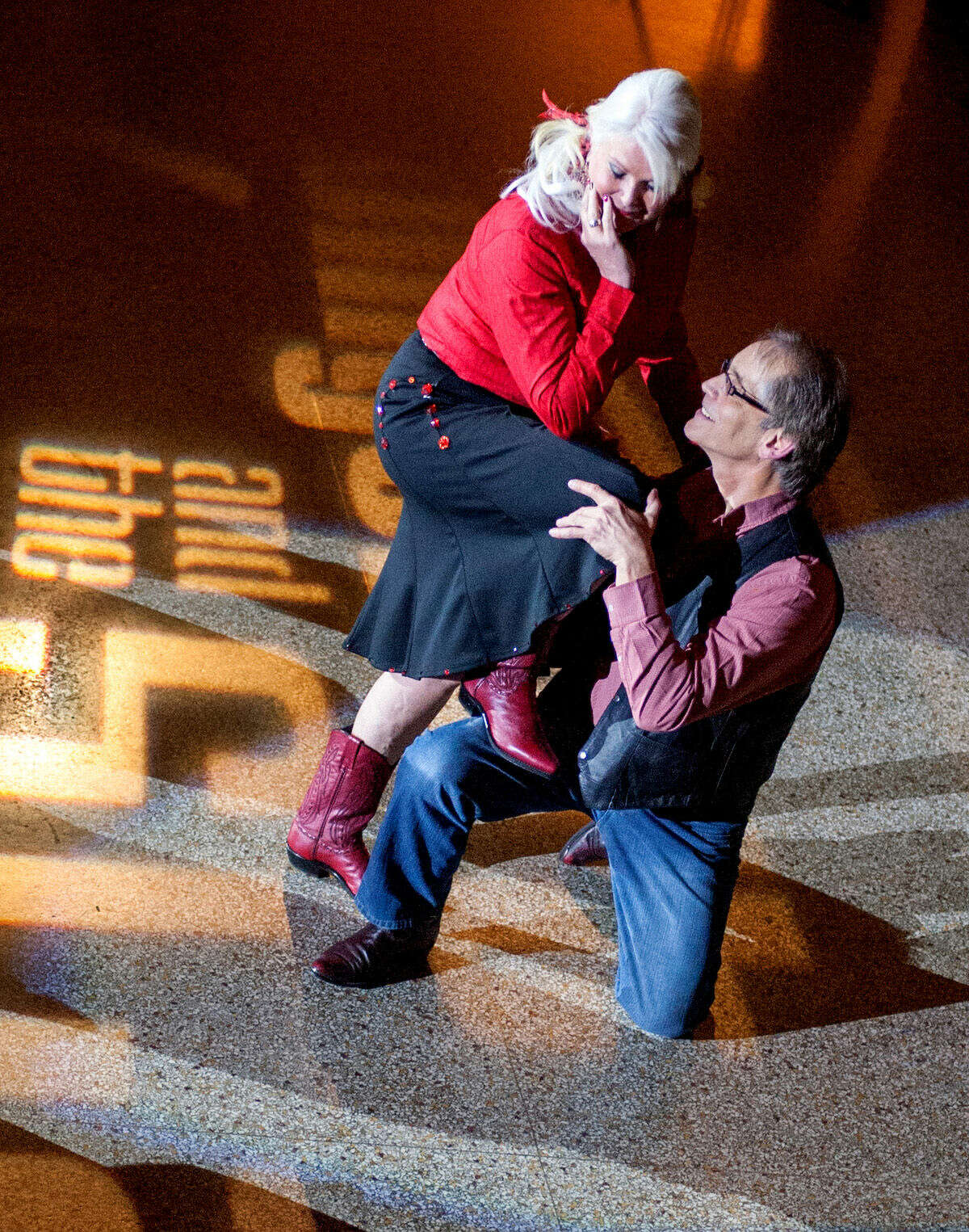 Wendy Traschen and Lon Wackerle dance the East Coast Swing for Family & Children's Services at Swingshift and the Stars at the Bay City Scottish Rite Masonic Center.