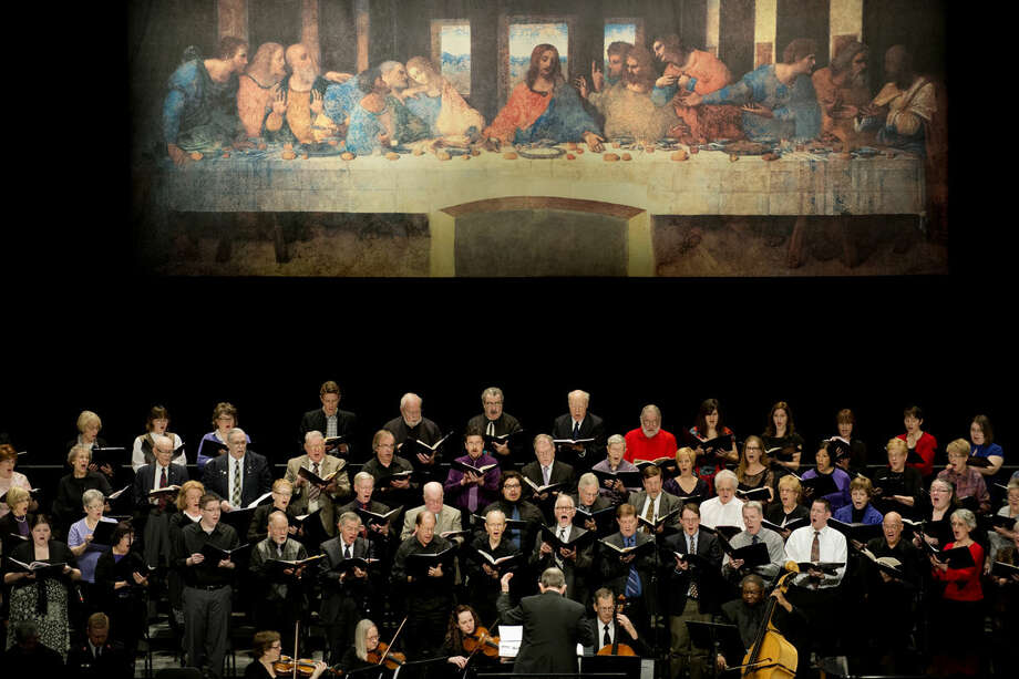"The Center Stage Chorale sings a hymn under a full-scale replica of Leonardo da Vinci's ""The Last Supper"" at the Midland Center for the Arts on Friday during a community wide Good Friday service. Rev. J. D. Landis of First United Methodist Church, Rev. Tom Schacher of Memorial Presbyterian Church, and Rev. Gerald Ferguson of Trinity Lutheran Church led the service. Photo: Neil Blake/Midland Daily News"