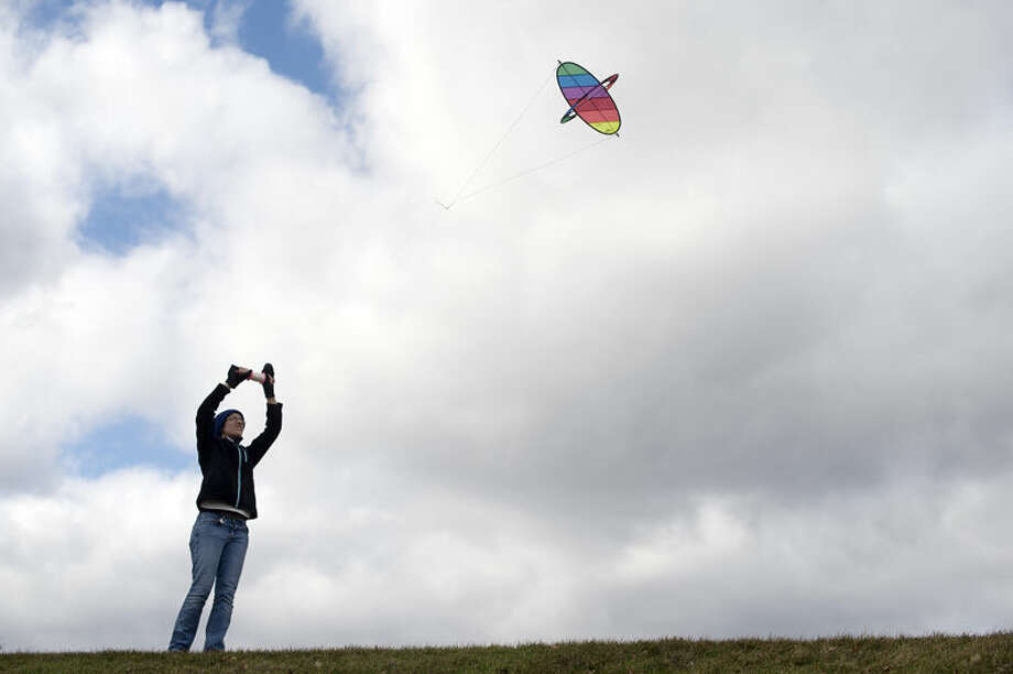 "Kayla Paulson of Midland flies her kite behind the former Central Middle School Friday afternoon. ""I woke up saw that it would be windy and I specifically packed it in the trunk of my car this morning,"" Paulson said. ""You gotta take advantage of the wind."" Photo: Brittney Lohmiller"