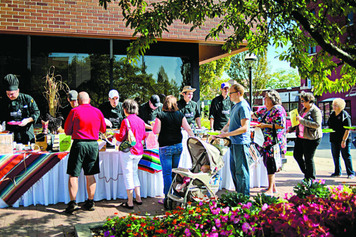 Patrons line up to try various chili and salsa made by the Midland Country Club during the 17th Annual Chili and Salsa Taste-Off on Saturday in downtown Midland.