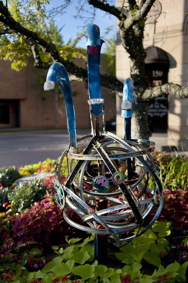 """Bicycle parts were used for this sculpture in downtown Midland. This year's Sculpture Series is called """"Gear Up for Summer"""" and features everything bicycle — sprockets, gears, unicycles and even a Harley-Davidson frame. Photo: Brittney Lohmiller 