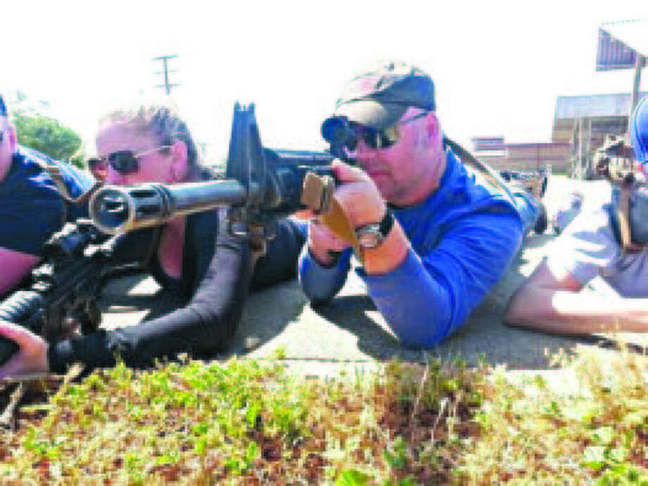 Daily News reporter practices on the firing range at Camp Pendleton, Calif.