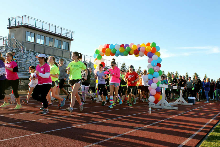 Runners take off from the starting line during the #LIVELIKEREED Glow Run at CMU's outdoor track Saturday night. Photo: Orrin Shawl | For The Daily News