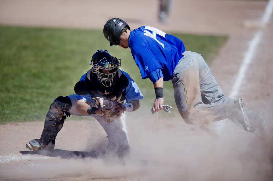 Northwood catcher Zyke Bailey tries to tag out Grand Valley's Aaron Ovverbeck during the first game of a doubleheader at Northwood University on Wednesday. Ovverbeck was called safe. Photo: Neil Blake | Midland Daily News